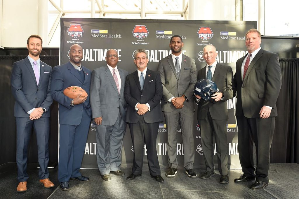 Jeff Bowler (Monumental Sports & Entertainment Vice President of Business Operations), Omarr Smith (Baltimore AFL Head Coach), Jack Young (Baltimore City Council President), Ted Leonsis (Monumental Sports & Entertainment Founder and Majority Owner), Marques Colston (AFL's Philadelphia Soul Ownership Group), Sean Huffman (MedStar Health Sports Medicine), Frank Remesch (Royal Farms Arena General Manager).