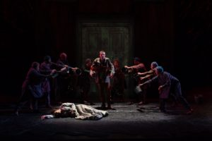 Orestes dispenses justice. Photo of the cast of The Oresteia by Scott Suchman.