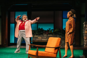 Falstaff (Brian Mani) uses his brazen skills of seduction on a surprised Mrs. Ford (Ami Brabson) on Folger Theatre's The Merry Wives of Windsor. On stage January 14 – March 1, 2020. Photo by Cameron Whitman Photography.